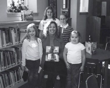 Books being presented to Elementary Students